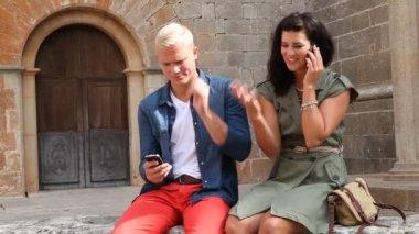 Happy couple using smartphone — Stock Video