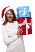 Woman in a Santa hat with gift boxes — Stock Photo