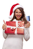 Smiling woman purchasing Christmas gifts — Stock Photo