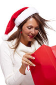 Christmas shopper with red shopping bag — Stock Photo