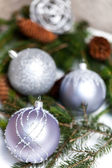 Silver Christmas ornaments in leaves — Stok fotoğraf