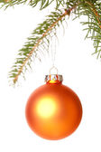 Christmas ball hanging from a branch of a fir tree — Stok fotoğraf