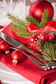 Red themed Christmas place setting — Stock Photo