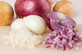 Whole, peeled and diced brown onion — Stock Photo
