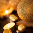 Warm gold and red Christmas candlelight background — Stock Photo #56788419