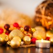Warm gold and red Christmas candlelight background — Stock Photo #56788471