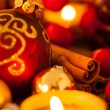 Warm gold and red Christmas candlelight background — Stock Photo #56788535