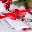 Romantic red Christmas table setting — Stock Photo #56789127