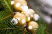 Golden Christmas decoration background — Stock Photo