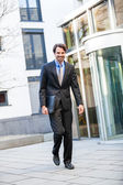 Businessman standing waiting for someone — Stockfoto