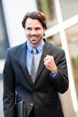 Motivated businessman punching the air — Stock Photo