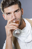 Sexy  man drinking white wine — Stock Photo