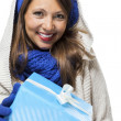 Woman holding a blue gift — Stock Photo #61430647