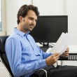 Man sitting in the office — Stock Photo #61431555