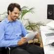Man sitting in the office — Stock Photo #61431623