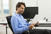 Man sitting in the office — Stock Photo