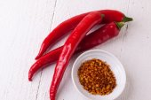Fresh red chili peppers with spice — Stock Photo