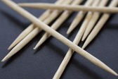 Wooden toothpicks scattered randomly — Stock Photo