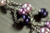 Shiny purple beads on jewelry — Stock Photo