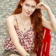 Pretty Woman Sitting on Chair — Stock Photo #66834785
