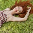 Happy Woman Lying on Grass — Stock Photo #66834809