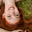 Happy Woman Lying on Grass — Stock Photo #66834821