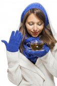 Fashionable woman sipping hot tea — Stock Photo