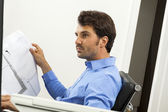 Man reading written agreements for work — Stock Photo