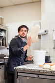 Chef tossing dough while making pastries — Stock Photo