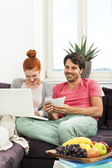 Couple at the Couch with Laptop — Stock Photo