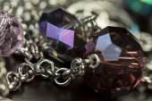 Shiny purple beads jewelry — Stock Photo