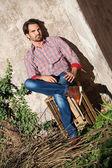 Male model sitting — Stock Photo