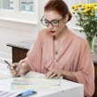 Sitting Young Businesswoman Writing — Stock Photo #69733379