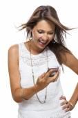 Vivacious woman reacting to a text message — Stock Photo