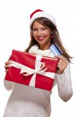 Woman with a Christmas gift — Stock Photo