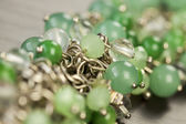 Pretty translucent green beads — Stock Photo