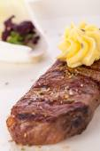 Grilled beef steak with butter — Stock Photo