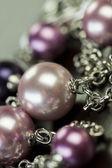 Three attractive shiny purple beads — Stock Photo