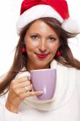 Woman in a Santa hat with cup — Stock Photo