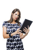 Attractive, brunette woman using tablet — Stock Photo
