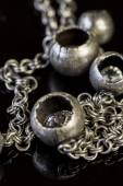 Assorted silver costume jewellery — Stock Photo