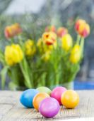 Easter eggs on a rustic table — Stock Photo