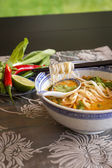 Spicy Asian soup with noodles — Stock Photo