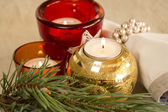 Christmas background with a golden candle — Stock Photo