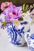 Summer flowers in a ginger jar — Stock Photo