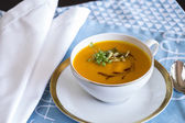 Garnished pumpkin Soup in Tea Cup — Stock Photo