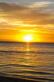 Tropical sunset over a calm ocean — Stock Photo