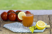 Glass of freshly squeezed tomato juice — Stock Photo