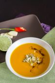 Bowl of pumpkin soup with garnishe — Stock Photo