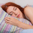 Attractive, red haired woman  sleeping — Stock Photo #74337711